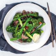 Beef and broccoli stir fry on a plate.